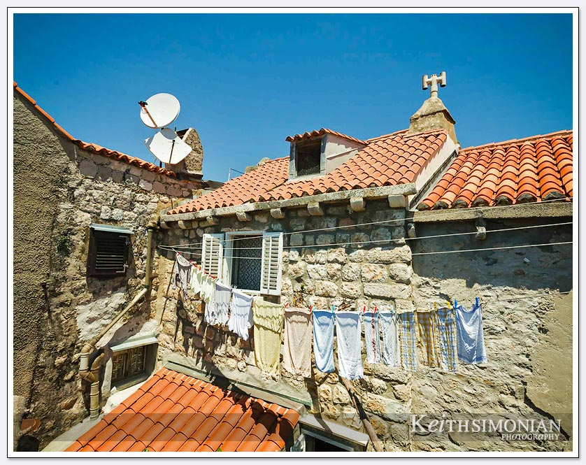 Laundry hangs outside one of the apartments that are inside the wall - Dubrovnik, Croatia