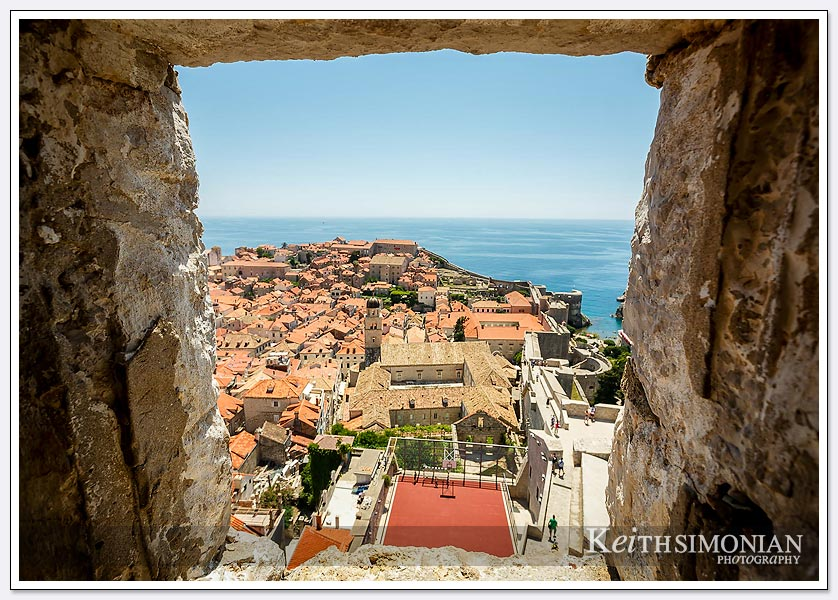 The city of Dubrovnik,Croatia seen through a window in the fort's wall.