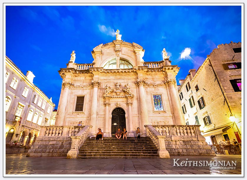 The blue night sky and tourists on one of the beautiful buildings in Dubrovnik, Croatia