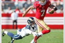 San Francisco 49ers quarterback Colin Kaepernick scrambles away from a St. Louis Ram defender during their 2014 game on November, 2nd at Levi's Stadium in Santa Clara, CA.