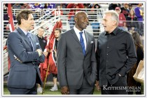 San Francisco 49er greats Steve Young, Jerry Rice, and Joe Montana on the sidelines for a halftime ceremony
