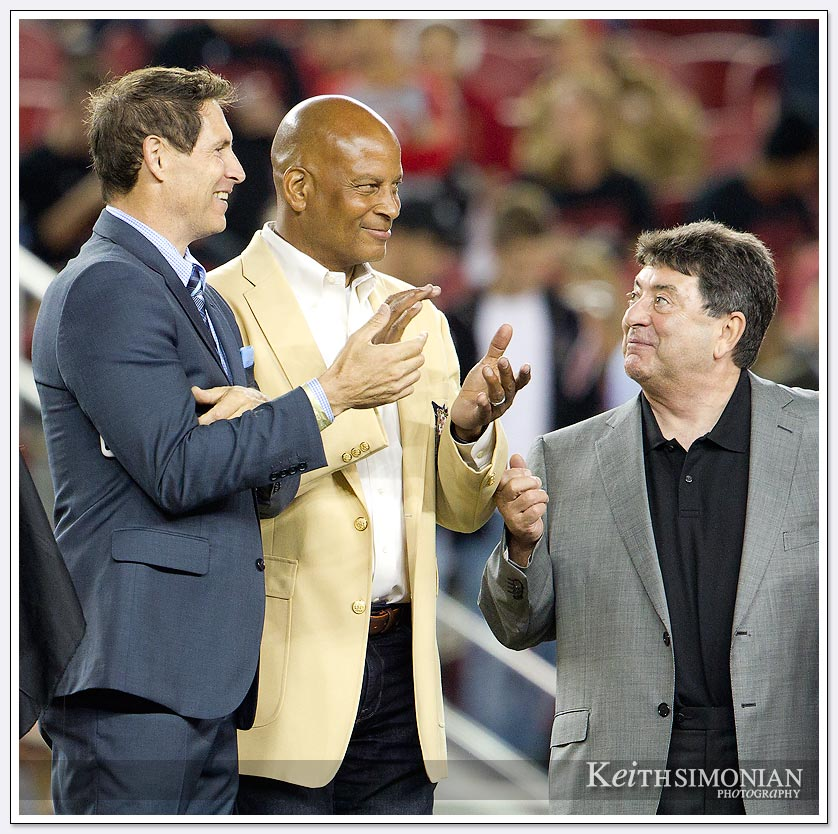 Steve Young, Ronnie Lott, and Eddie DeBartolo during a half time presentation to Charles Haley.