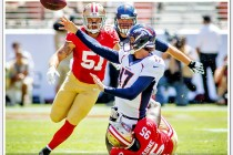 Backup quarterback Denver Bronco quarterback Brock Osweiler releases a pass while being tackled during a 2014 preseason game against the San Francisco 49ers at Levi's stadium in Santa Clara.