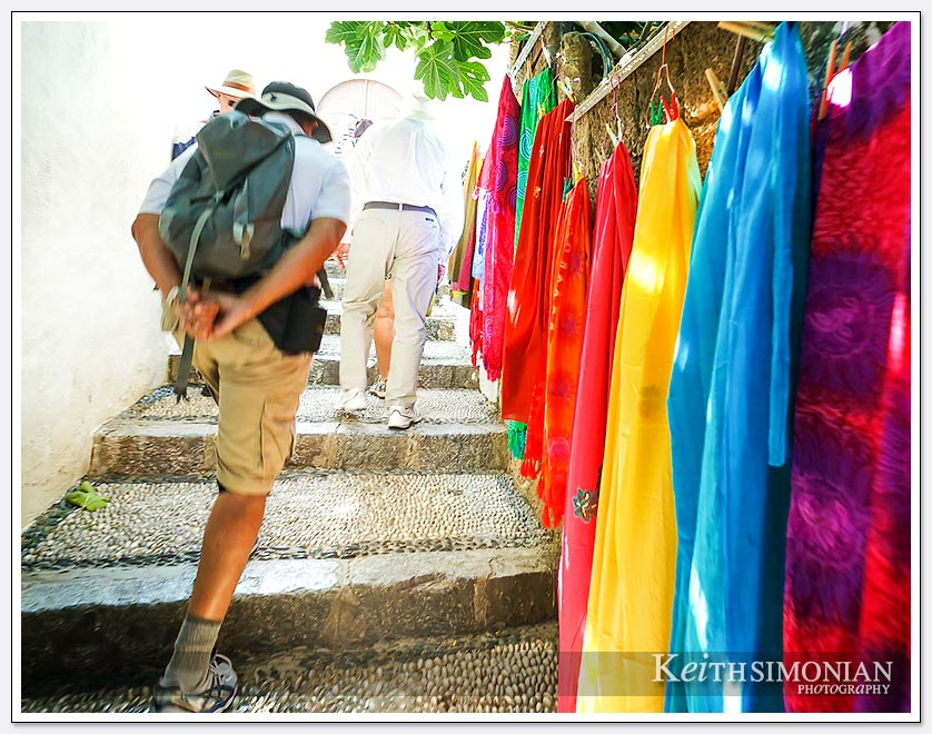 Climb up the stairs past the tourist shops to the Acropolis of Lindos