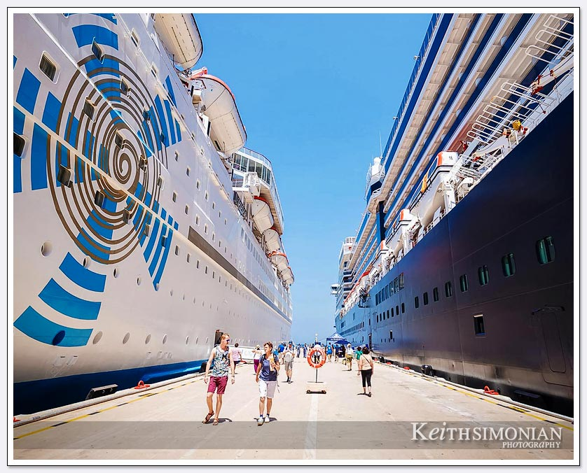 Two cruise ships are parked at the cruise terminal in Kusadasi, Turkey