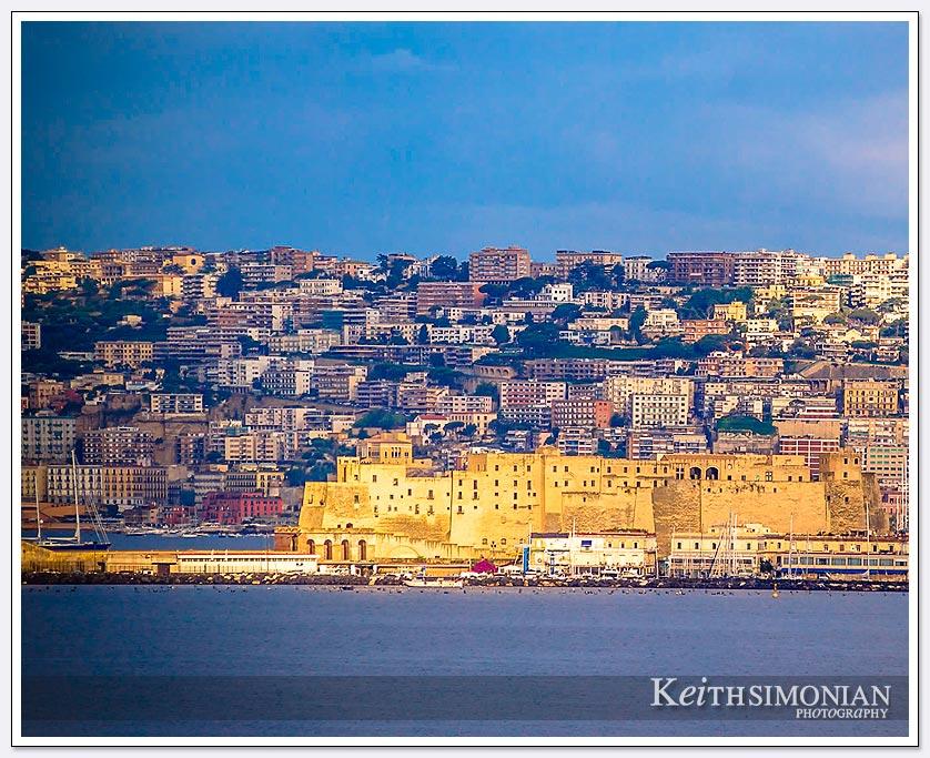 Golden sunlight hits the port buildings in Naples, iItaly