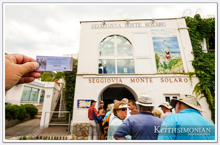 Tourist holding ticket to the Seggiovia Monte Solaro - Capri, Italy