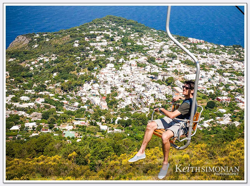 Single seat chair lift on Capri Island with views of the Mediterranean Ocean
