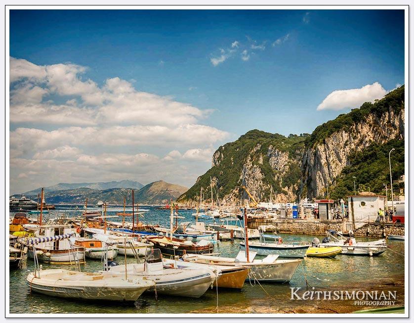 Port of Capri, Italy with many small sailing ships.
