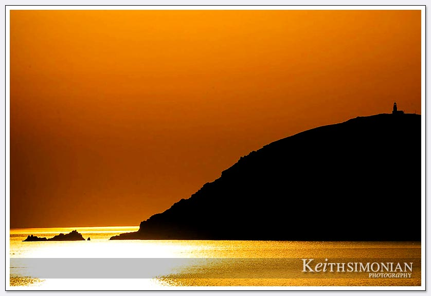 Lighthouse at sunrise in the Aegean Sea