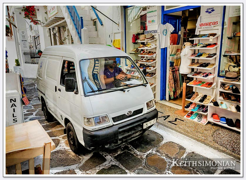 There are no roads in the old town of Mykonos, Greece so the deliveries are made by quite small trucks to the shops.