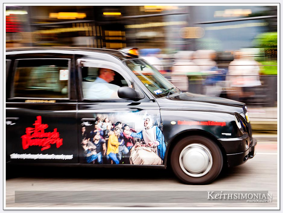 Ads adorn taxi cabs in Edinburgh Scotland