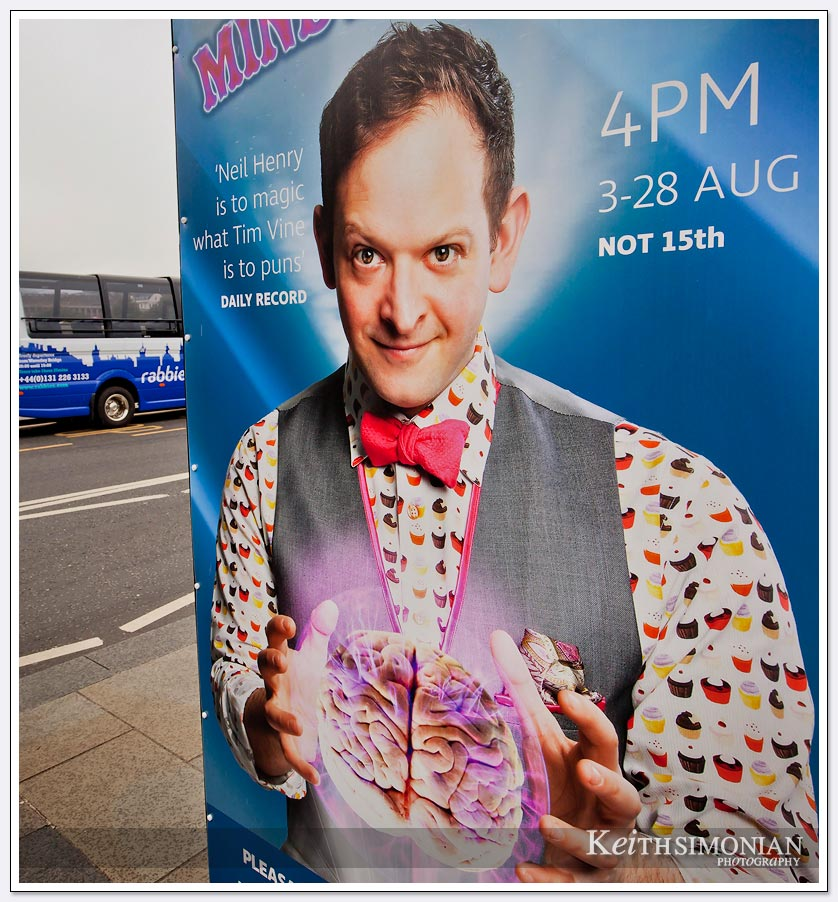 Sidewalk ad for a magician in Edinburgh Scotland
