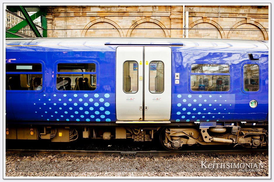 Blue railway car in the Edinburgh train station