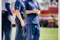 Quarterback Tony Romo stands alongside Dallas Cowboys head coach Jason Garrett