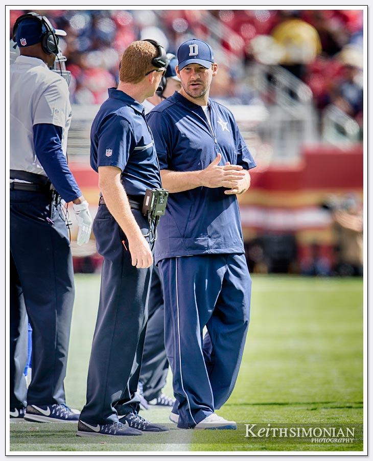 Quarterback Tony Romo stands alongside Dallas Cowboys head coach Jason Garrett