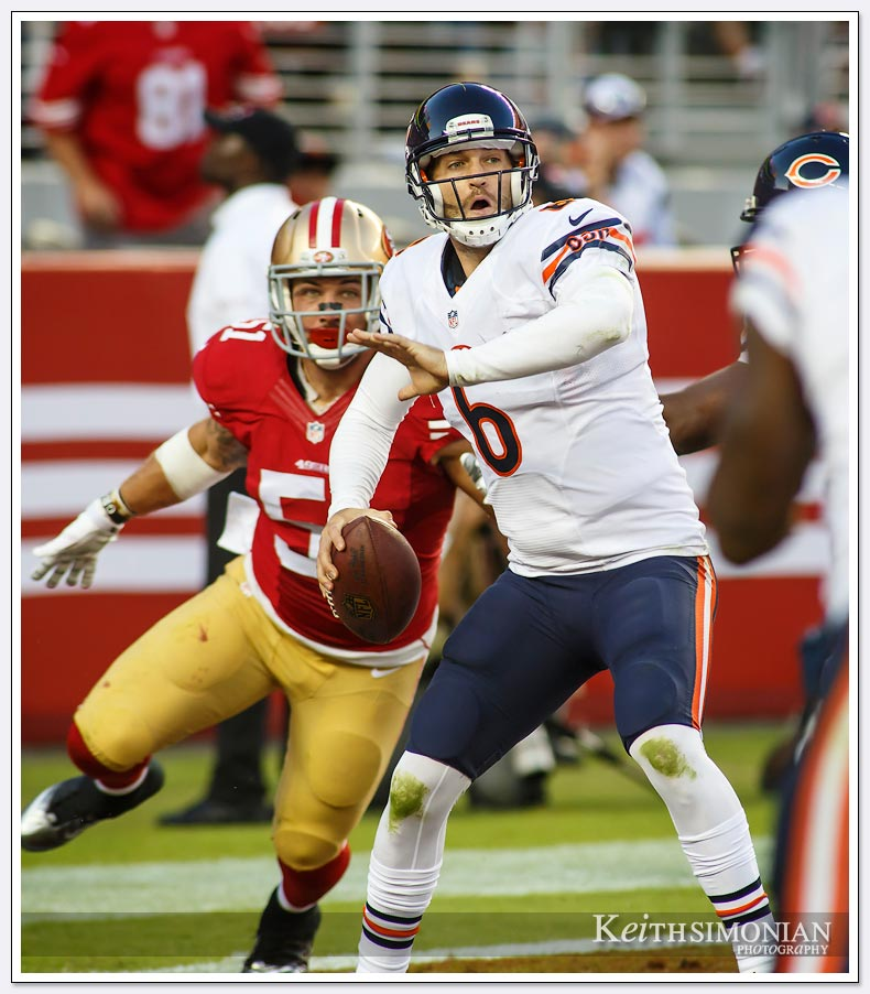 Chicago Bears quarterback Jay Cutler eludes the pass rush of the San Francisco 49ers.