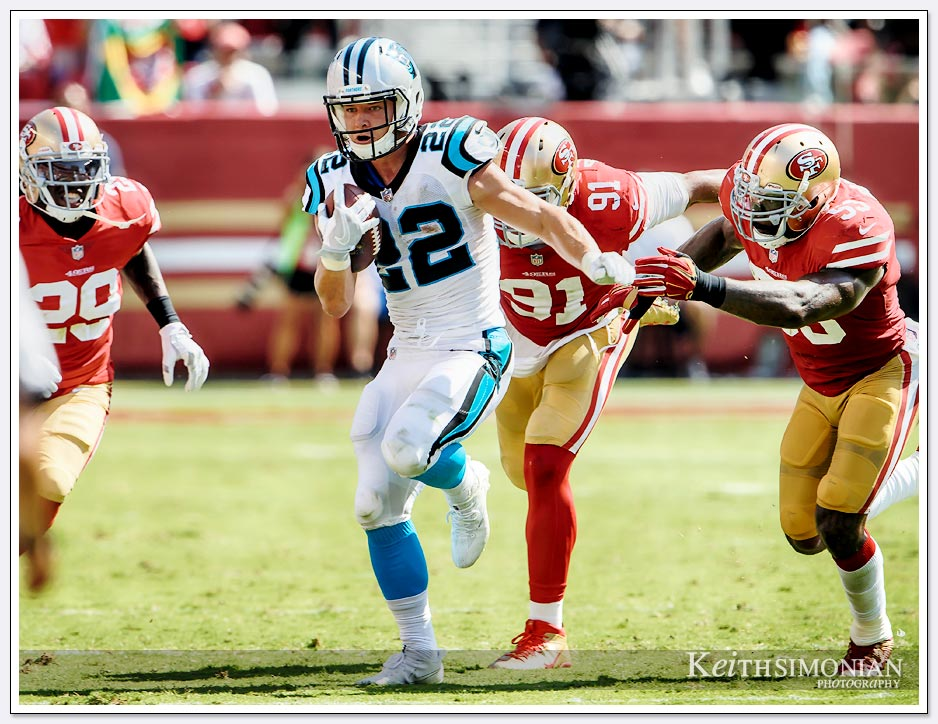 Carolina Panthers running back #22 Christian McCraffey eludes 49ers defends during the Panthers September 10, 2017 victory over the San Francisco 49ers at Levi's Stadium in Santa Clara.