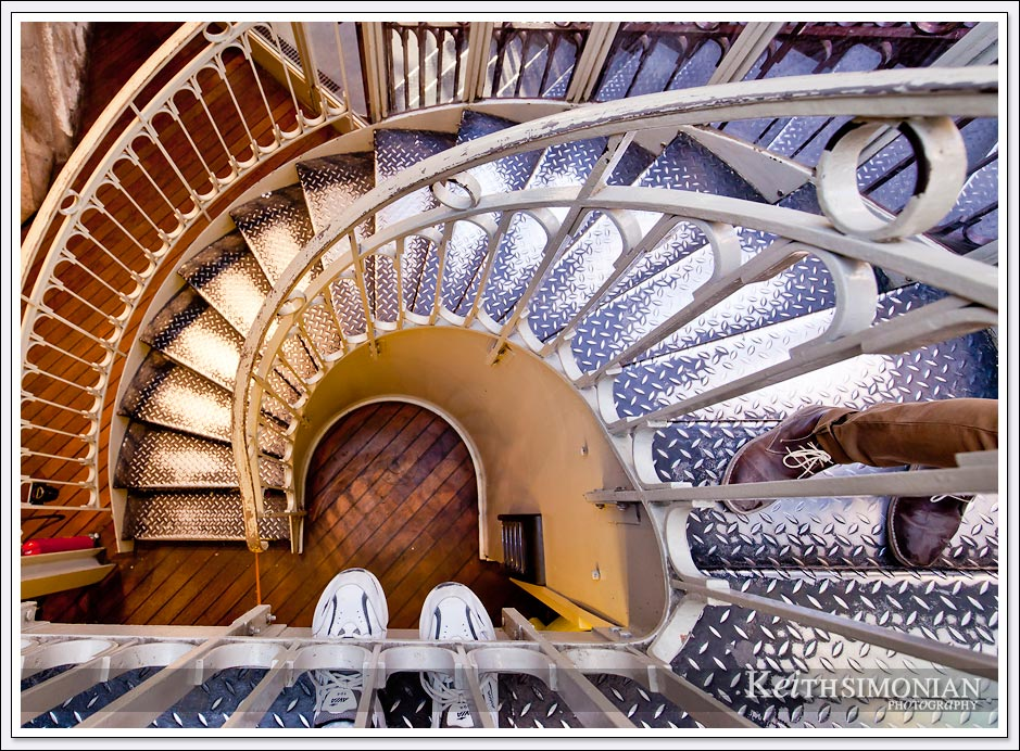 Stairs which allow you to climb to the top of the Eiffel Tower in Paris France. I would suggest taking the elevator