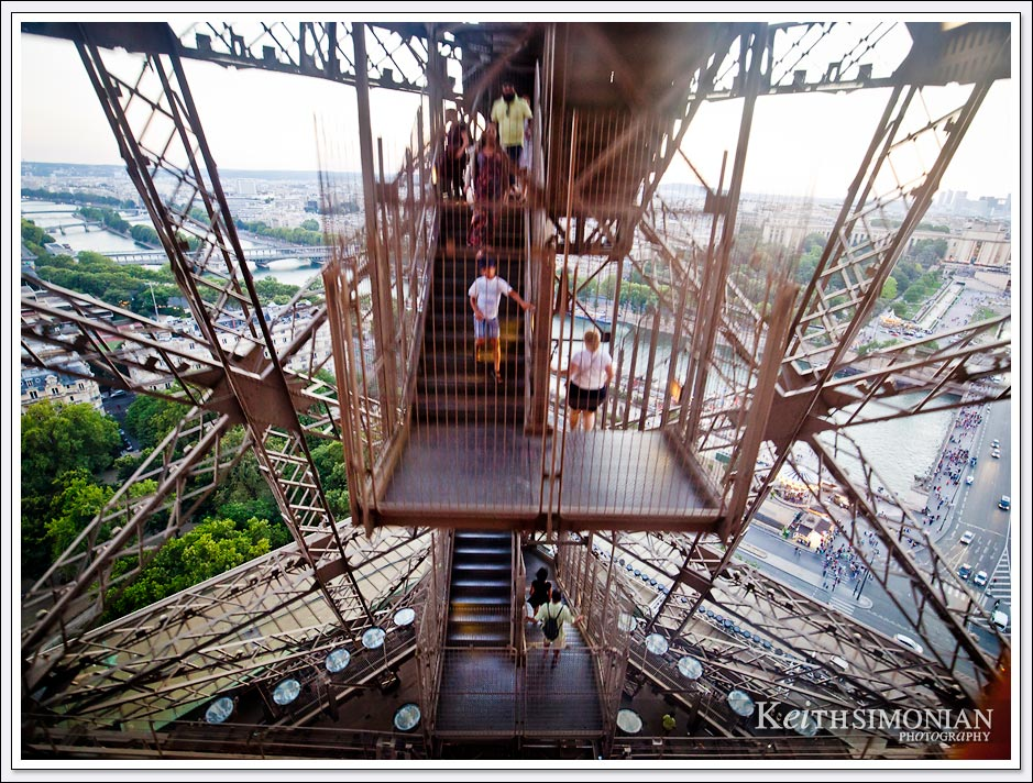 Taking the elevator down from the top of the Eiffel tower one sees that stairs the also take visitors to ground level - Paris France