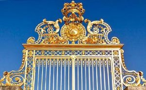 The restored Gold Leaf adorns the main gate to the Palace of Versailles in France