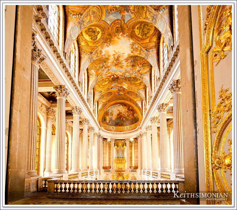 Amazing view of paintings and columns in the Palace of Versailles, France