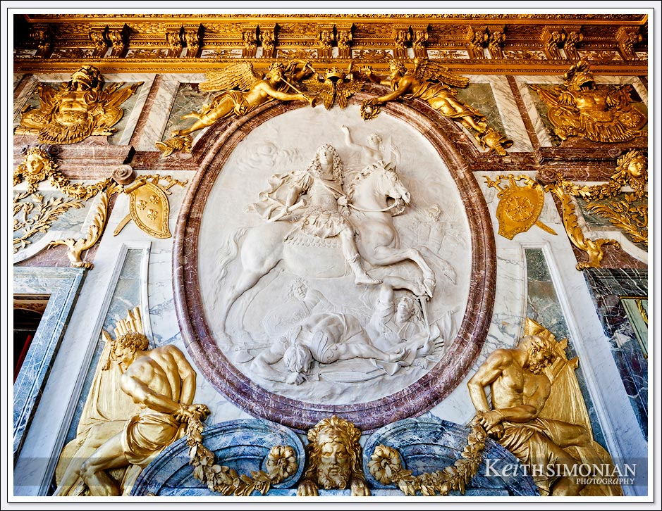 Gold and marble adorn the War Salon in the Palace of Versailles, France