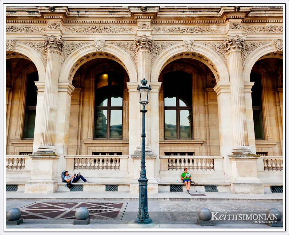 The courtyard of the Louvre in Paris France is a wonderful location to take a break and read a book.