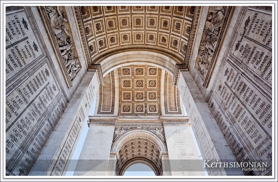 The Arc de Triomphe serves a memorial to French military victories - Paris France