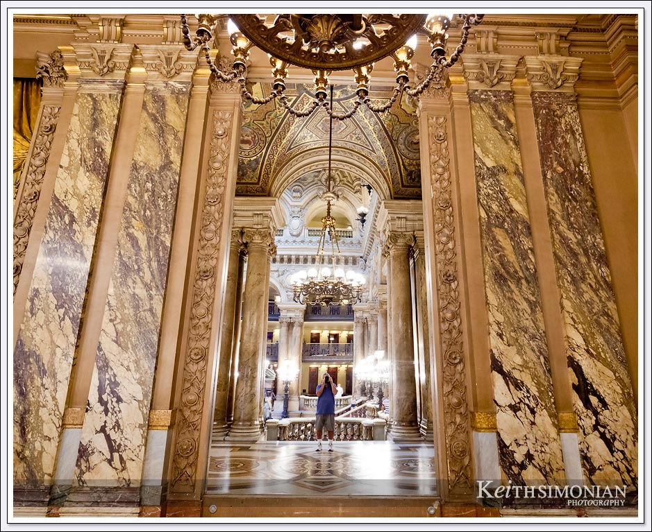 Photographer's reflection in the mirror of the Palais Garnier - Paris France
