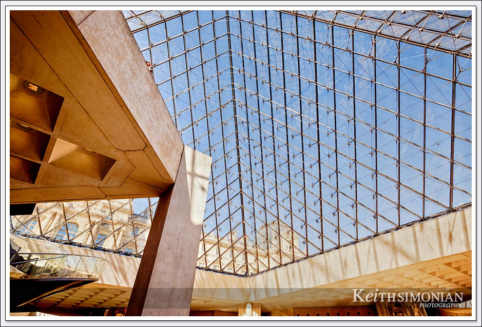 One enters the Louvre through the glass pyramid in the courtyard - Paris France
