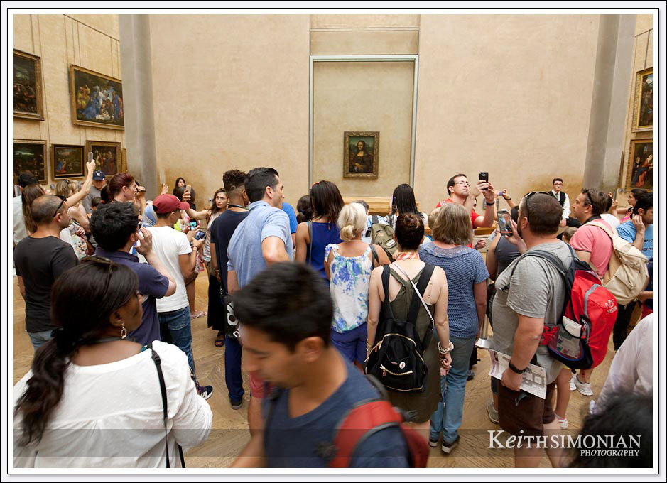 The crowds that are always present around the Mona Lisa painting in the Louvre - Paris France