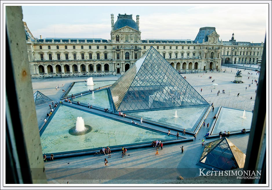 From the 2nd story of one of buildings that make up the Louvre museum you can see the glass pyramid that is the entrance to the complex.