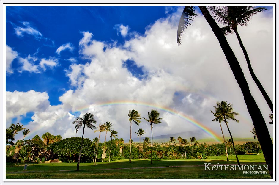 Clouds and a full rainbow just above the golf course at the Maui Hyatt Regency