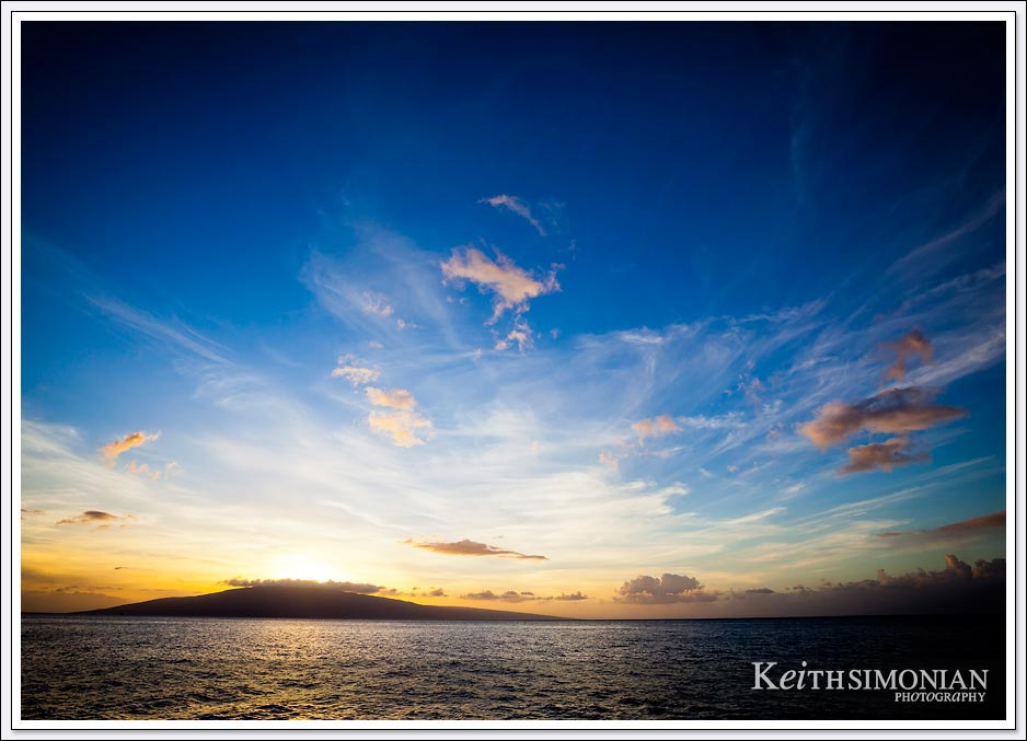 A sunset cruise with wonderful clouds that frame the island of Lanai Hawaii