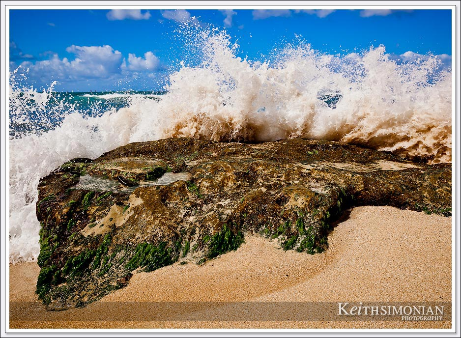 The water pulls back from the beach then comes crashing back on the rocks with all the power of nature.