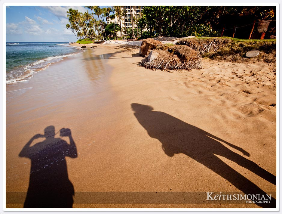 Walking along the Maui beach with the sun casting our shadows into the photo