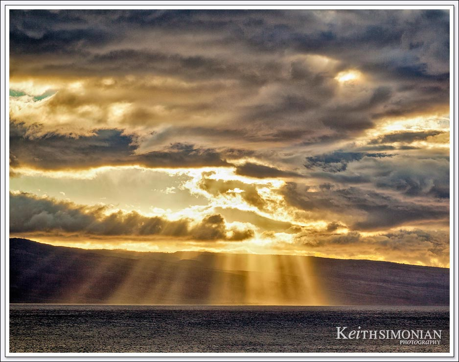 Sunlight passing through the storm clouds - Maui Hawaii