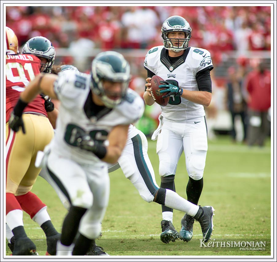 Philadelphia Eagles quarterback backs up in the pocket while looking for a receiver during this 2014 match up against the San Francisco 49ers in Levi's Stadium in Santa Clara.
