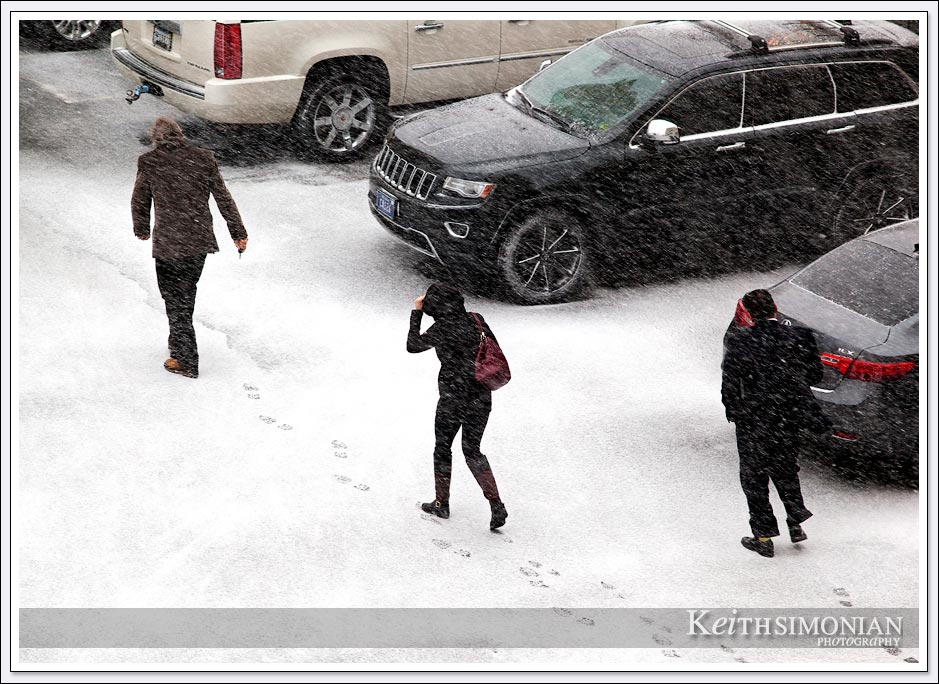 Hotel guests braving the snow to reach their cars in Reno, Nevada.