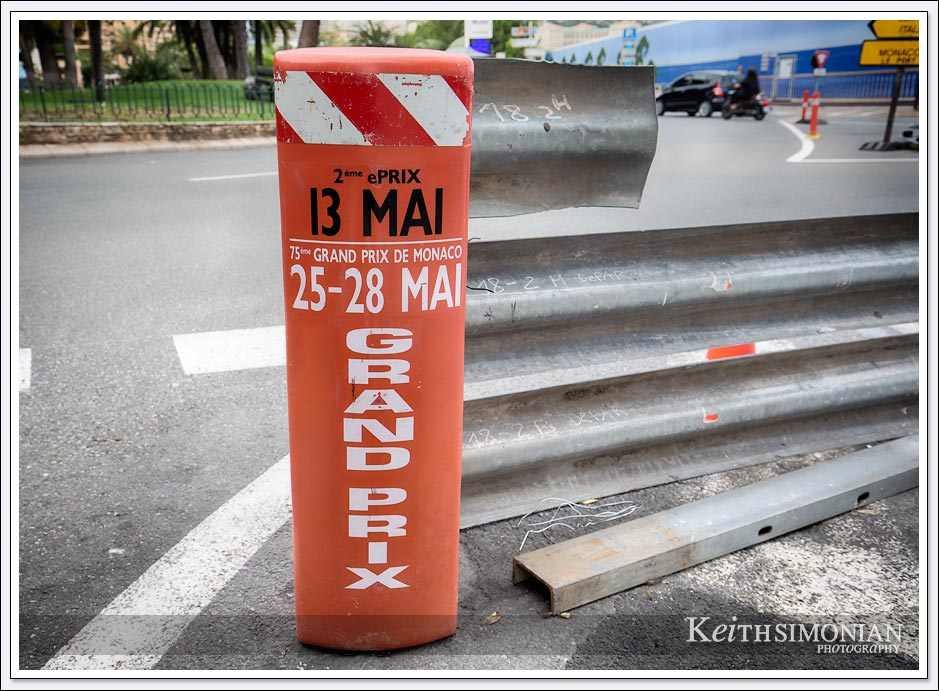 Sign on metal barrier showing the date of 75th Monte Carlo grand prix in Monaco.
