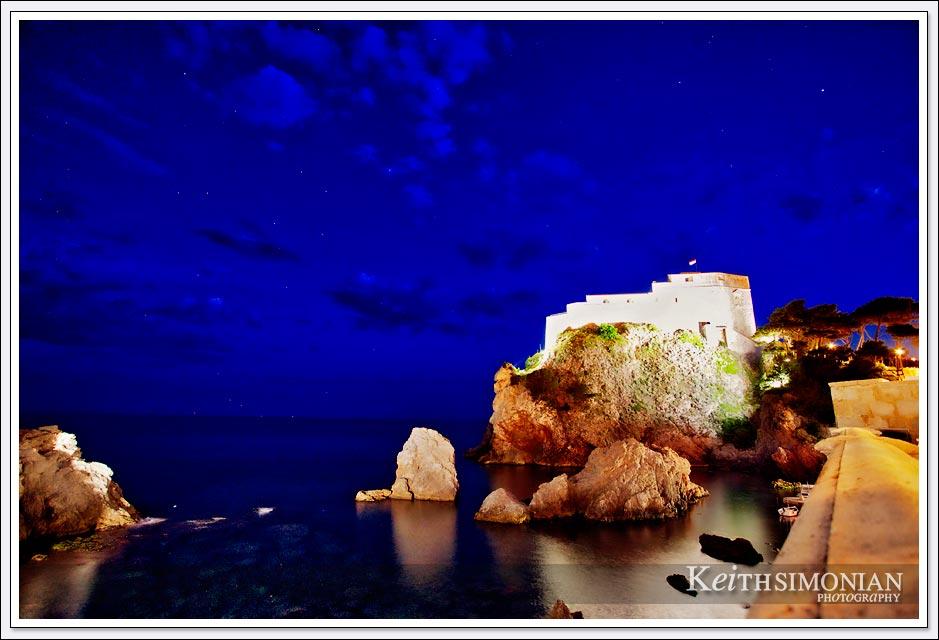 Lights illuminate the castle wall at night - Dubrovnik, Croatia