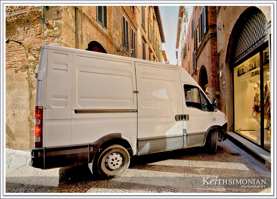 The street of Lucca, Italy weren't built oh so many years ago with modern day delivery trucks in mind.