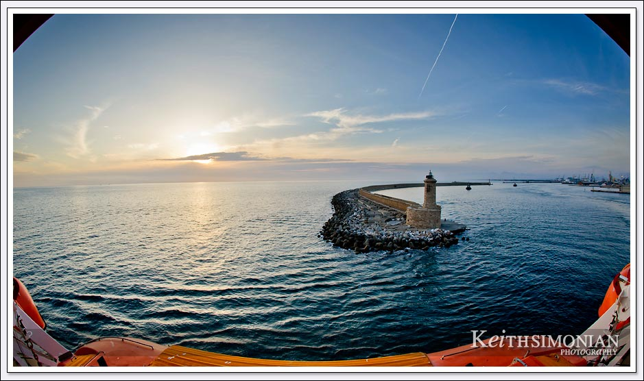 Fisheye photo of sunset pulling out of port in Livorno, Italy
