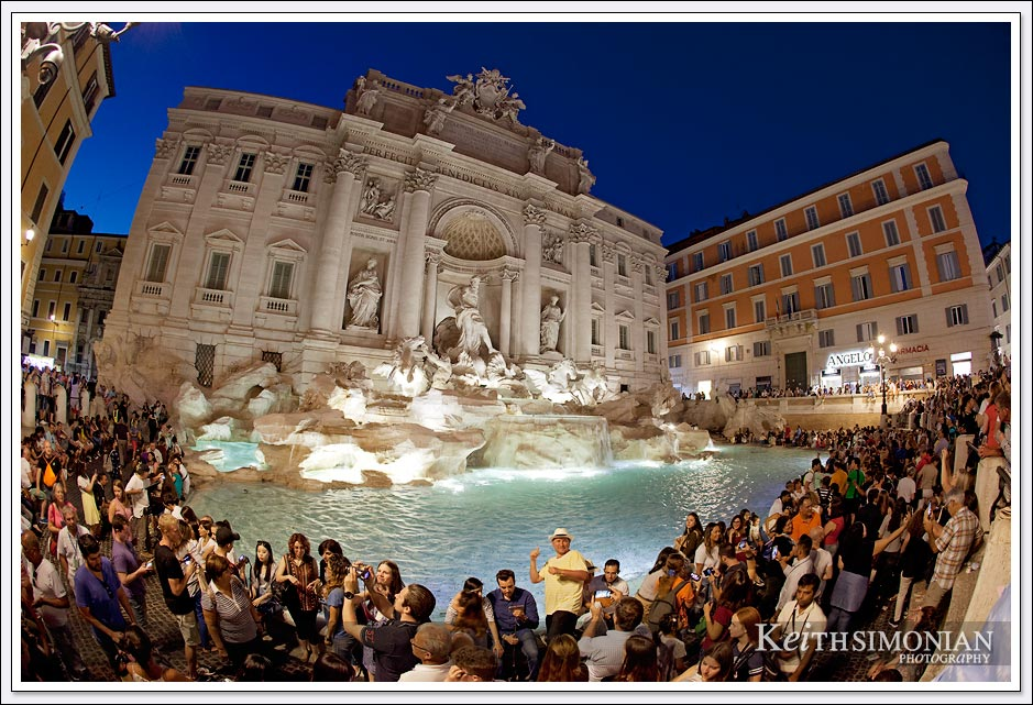 Fish eye view of the Trevi fountain and the crowds that visit it daily in Rome Italy