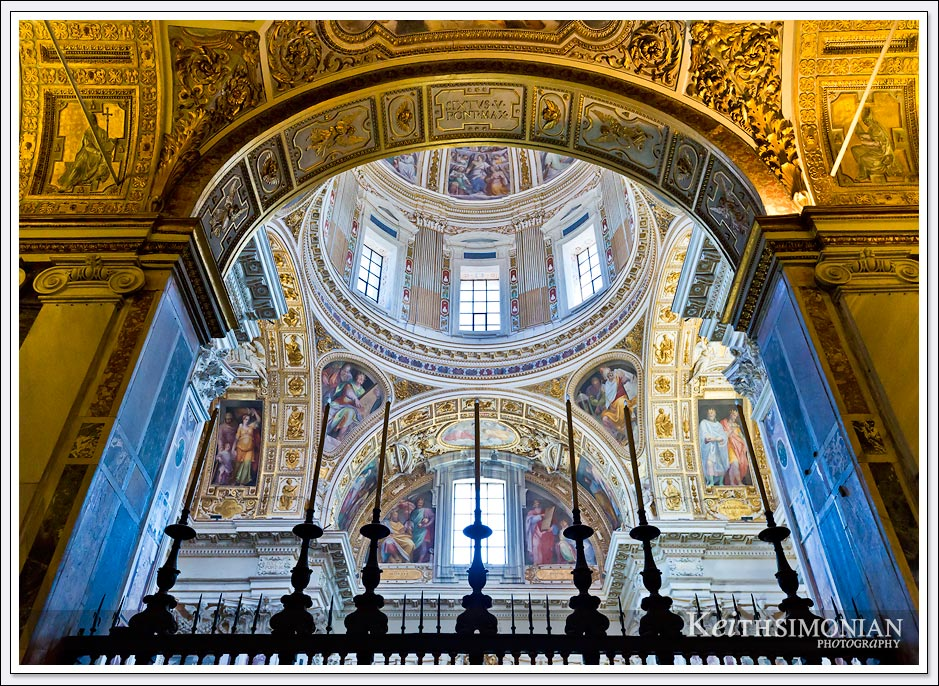 Candles in the foreground with the dome of the Basilica di Santa Maria Maggiore in the background - Rome, Italy
