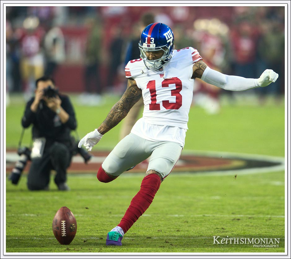 New York Giant Odell Beckham Jr. practices making a field goal during pre game warm ups.