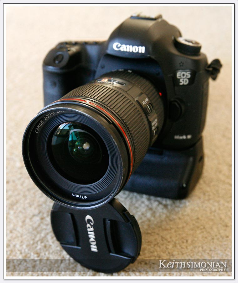 The lens cap of the Canon 16mm to 35mm zoom works as an on the go tripod for long exposure photos.