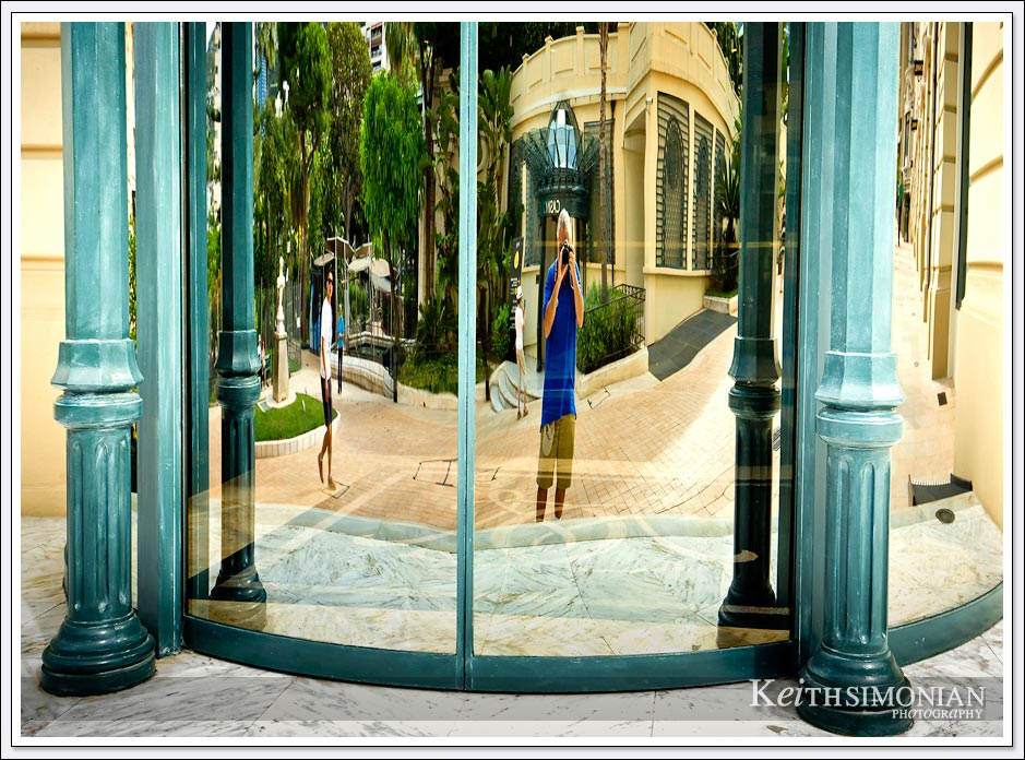 Nothing says tourist like taking a photo of your reflection in the window of an expensive shop in Monte Carlo.