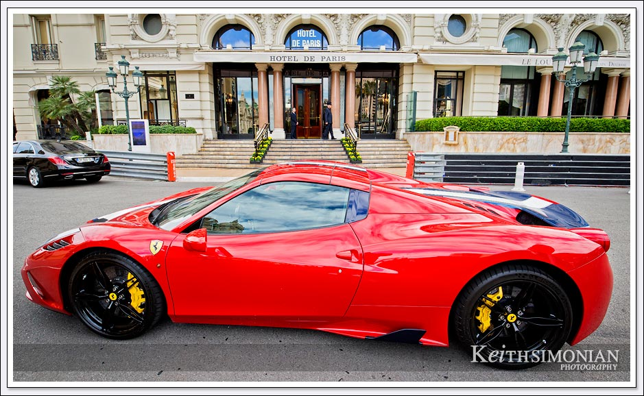 This red Ferrari is parked in front of the Hotel de Paris in Monte Carlo.